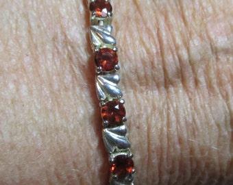 Ladies fine heavier garnet bracelet in heavier sterling silver