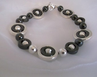 Hematite-Silver Circles 8 inch Bracelet.  Cool, Calm and Collected