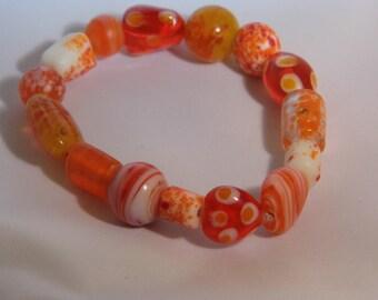 Summer orange burst lamp work beads