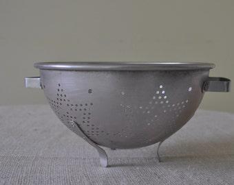 Vintage 1950's aluminum star colander, 3 legs, 2 handles. Shiny, Retro, Many Uses.