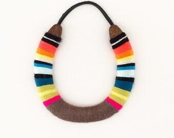 Serape style lucky yarnbombed horseshoe