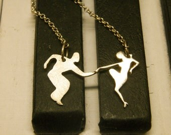 Silver Dancers Pendant or earrings