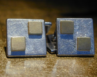Sterling Silver cufflinks with squares of 22 carat gold