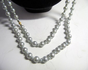 Long string of gray pearl beads, long enough to double. 58""