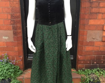 Cute 1950's dress with black velvet bodice and green patterned skirt