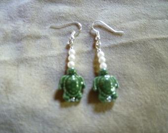 green sea turtle with pearl bead earrings