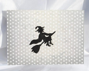 Less  than half price clearance sale black  flying witch on a pastel grey halloween card