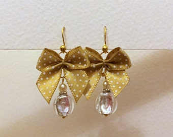 Earrings with Venetian beads topped with yellow bows