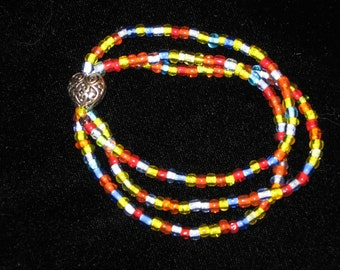 Triple strands of rainbow seed beads and silver filigree heart stretch bracelet