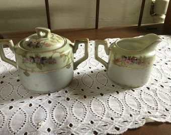 Hand painted sugar and creamer with gold trim