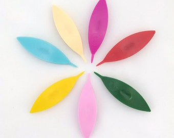 Boye tatting shuttle with point.  Plastic. 2.75 inches long, with center post. Pink, Ivory, Red, Green, Blue, Yellow, Fuchsia