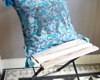 turquoise batik cushion with elephant