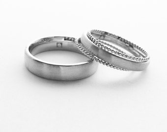 Wedding rings made from 925 Silver with two beads rings