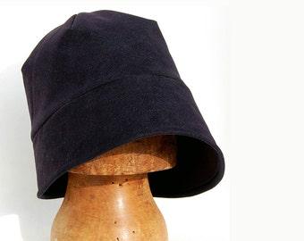 Gaberdine asymmetrical cloche rain hat