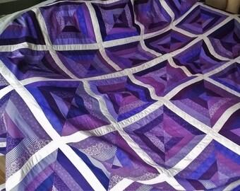 Purple strip pieced quilt