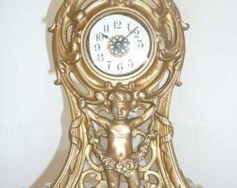 Art Nouveau cast iron dresser clock with cherub Westclox La Salle - circa 1906