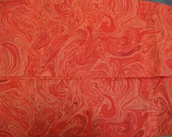 100 percent cotton marbled orange fabric/quilting/crafts/apparel