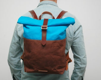 """waxed Canvas rucksack/backpack,  sky blue/chocolatte color, hand waxed , with handles, leather  and closures""""limited edition"""""""