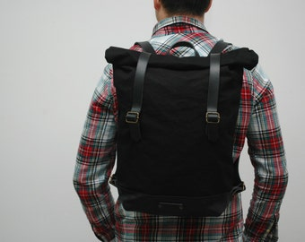 waxed Canvas rucksack/backpack, black color, hand waxed , with handles,double closure, leather base and closures