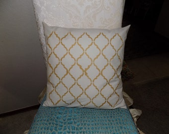 Hand stenciled pillow in gold paint