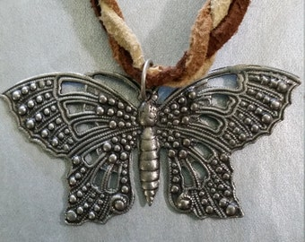 Butterfly on braided leather cord