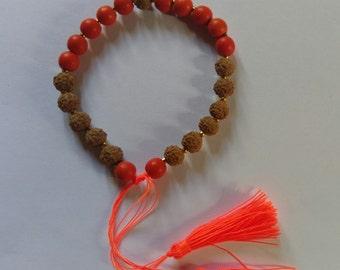 Handmade seed and stone bead with tassle bracelet.