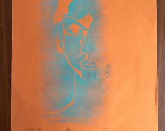 Blue Linograph (?) of Face on Orange Paper