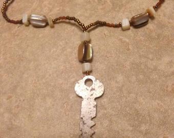 Neutral vintage key necklace