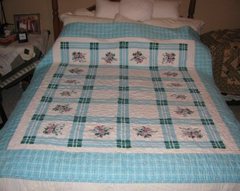 Quilted vintage table cloth from the 1930s. 64 inches x 68 inches