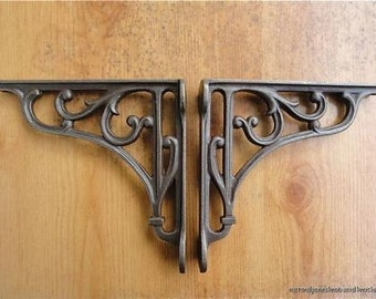 A pair of small classic Victorian scroll shelf brackets 6 inch bracket cast iron