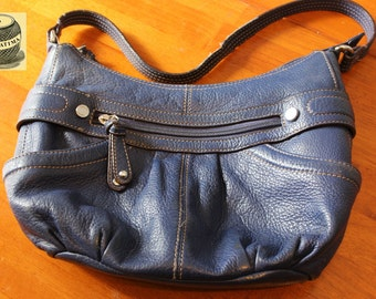 Navy Blue Leather bag with front and back zipper pockets, small side pockets and inside zippered pocket, zipper enclosure. By Tingnangello