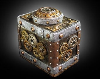 Pet Urn packed with steampunky goodness! This clay over wood box is sculpted with the look of a worn, beat up, metal box adorned with gears.