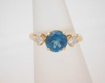Ladies Round Cut Blue Topaz & Princess Cut Diamond Ring 14K Gold