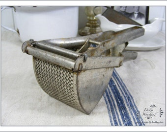 Antique french potato masher - country living