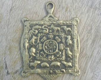 Antique Tibetan Brass Pendant.