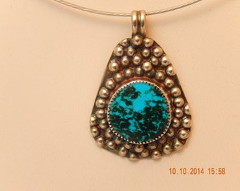 Kingman spider web turquoise and sterling silver pendant