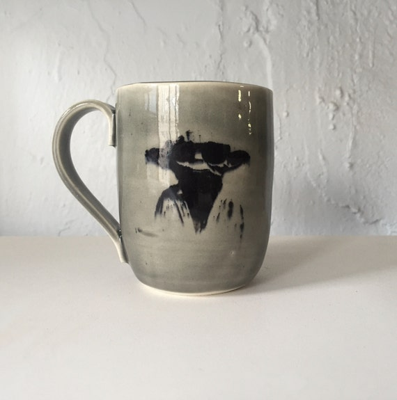 Handmade grey ceramic yoda themed mug.
