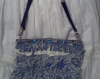 Small bag handmade denim covered with strips of jean