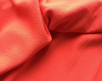 Deep Coral Jacquard, made in France, a stunning and elegant matte piece, 1 1/8 wide with a lifted pattern, 58 inches wide
