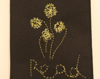 black 2mm thick felt kindle case with yellow/light green embroidered flowers