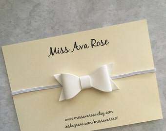 White faux leather bow on white headband, white faux leather bow, white bow headband, baby bow, girls bow