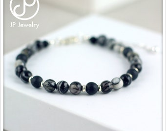Handmade bracelet with black silk stone and matte black stone gemstone beads, 925 sterling silver beads and details.