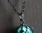 Teal Ornate Glowing Orb Pendant Necklace Locket Black,  glow Jewelry
