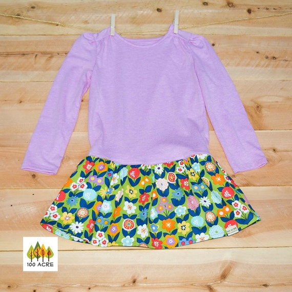 Lavender long sleeve t-shirt dress for girls with flower skirt. Flower print: blue, red, orange, white, orange and lavender flowers