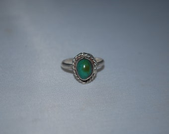 Sterling silver ring size 3.5 with turquoise setting.