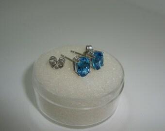 Blue Topaz 7 x 5 mm Oval Stud Earrings Set In 925 Silver-TCW 2.20 Carats-INTENSE SATURATION & Clarity-Super Swiss Blue-November Birthstone
