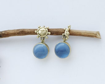 Sun and moon brass earrings with blue glass