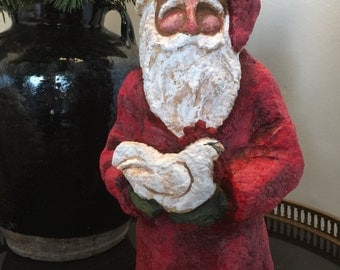 Paper mache' santa with a chicken