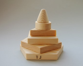 Personalized wood pyramid. Geometric pyramid