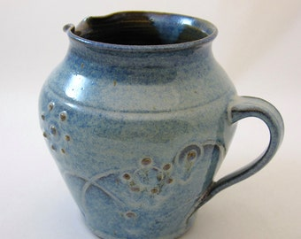 Stoneware pitcher, thrown and hand-carved, slip-trail decoration glazed in Chun blue